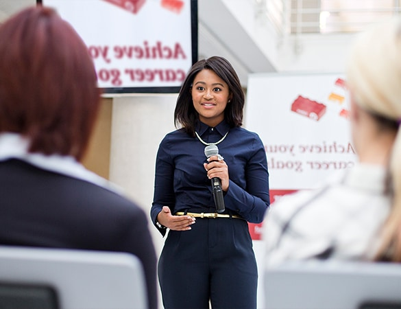 Woman in navy shirt giving a presentation