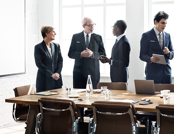 Group of people in a meeting room shaking hands