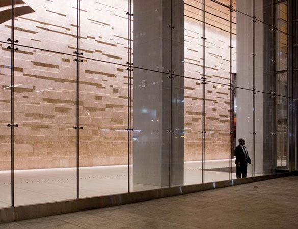 Man standing at glass doors in building