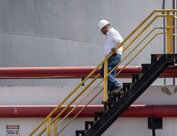 Man walking down the stairs at power-plant