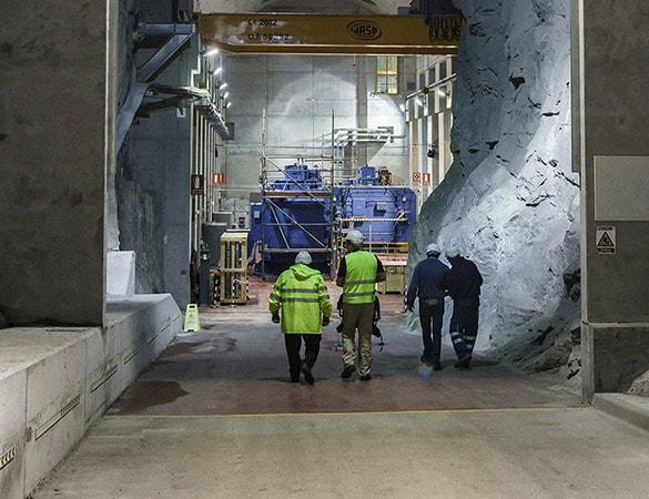 Four men walking in a mining shaft
