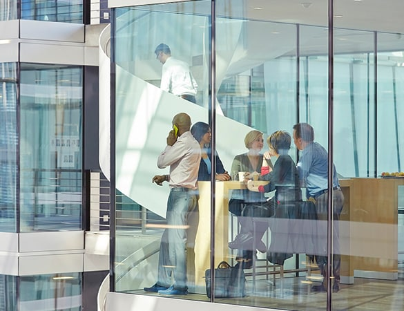 Group of people in a glass office builing