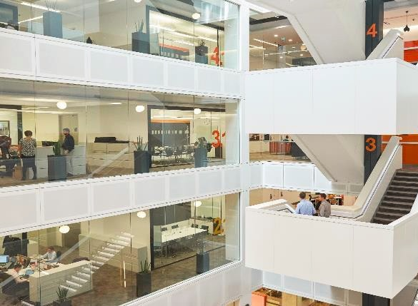 White stairs inside building with people walking down