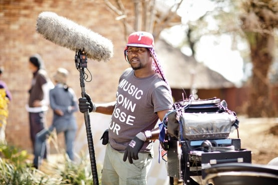 Entertainment & media - Male audio technician at film shoot with equipment